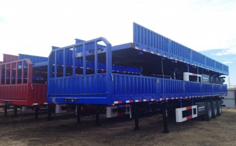 Универсальный полуприцеп бортовой-контейнеровоз для тяжелых условий.